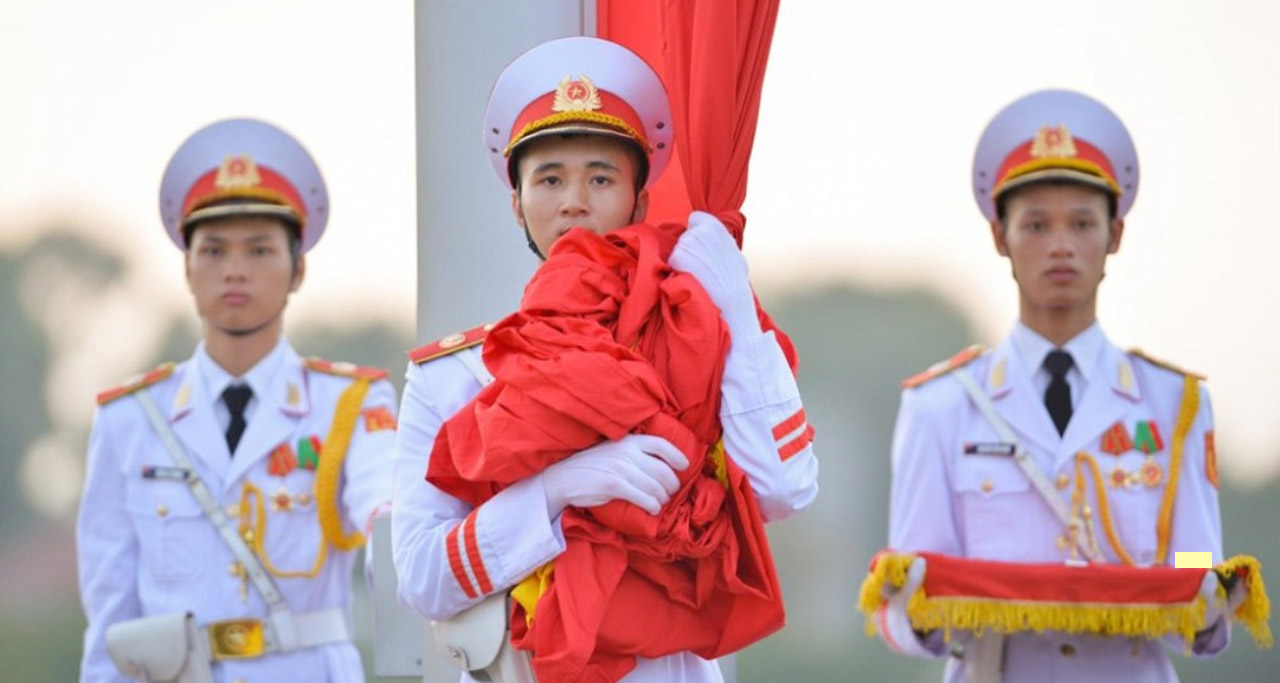 The ceremony of raising the Vietnam National Flag at Ba Dinh Square